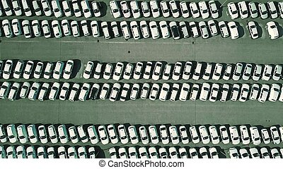 Aerial top down view of a car manufacturer warehouse -...