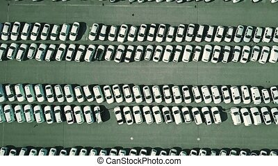 Aerial top down view of a car manufacturer warehouse