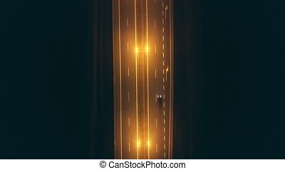 Aerial top-down view of a foggy car road at night - Aerial...