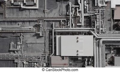 Aerial top down view of a futurisic technology manufacturing plant. Cinematic 4K establishing shot.
