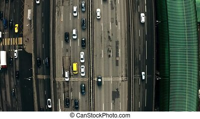 Aerial top down view of beginning of a city road traffic jam...