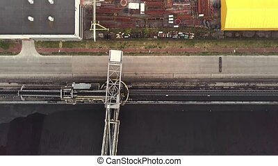 Aerial top down view of bulldozer and conveyor on the top of...
