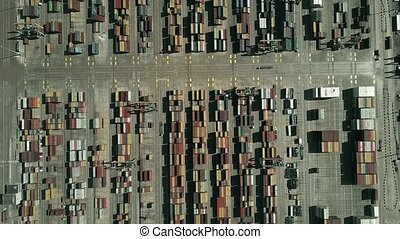 Aerial top-down view of busy port container terminal -...