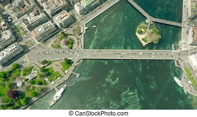 Aerial top down view of famous Mont Blanc Bridge in Geneva,...