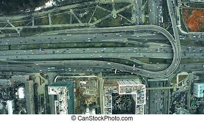 Aerial top down view of major city roads and interchange -...
