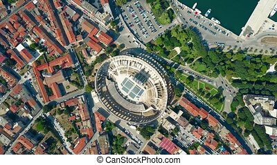 Aerial top down view of Pula city and famous ancient Roman amphitheatre in Croatia
