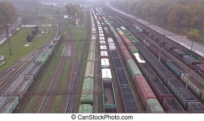 Aerial top down view of railway hub and parked freight...
