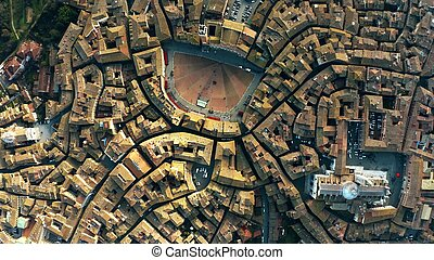 Aerial top-down view of Siena involving Piazza del Campo or ...