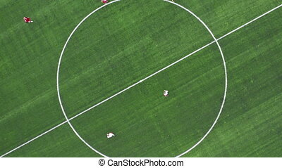 Aerial Top Down View of Soccer Field. Beginning of game. Two...