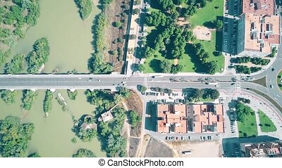 Aerial top down view of streets and bridge in Cordoba, Spain...