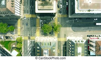 Aerial top down view of streets and buildings in Geneva,...