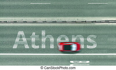 Aerial top-down view of the road. Cars reveal Athens text. Travel to Greece 3D rendering