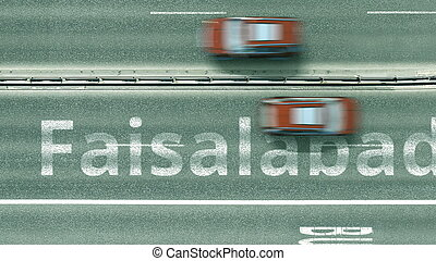 Aerial top-down view of the road. Cars reveal Faisalabad text. Travel to Pakistan 3D rendering
