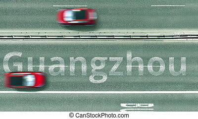 Aerial top-down view of the road. Cars reveal Guangzhou text. Travel to China 3D rendering