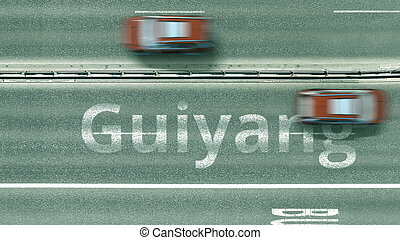 Aerial top-down view of the road. Cars reveal Guiyang text. Travel to China 3D rendering