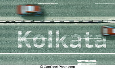 Aerial top-down view of the road. Cars reveal Kolkata text. Travel to India 3D rendering