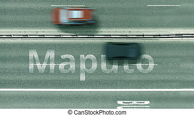 Aerial top-down view of the road. Cars reveal Maputo text. Travel to Mozambique 3D rendering