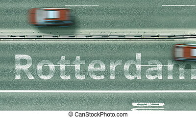 Aerial top-down view of the road. Cars reveal Rotterdam text. Travel to Netherlands 3D rendering