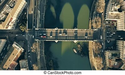 Aerial top down view of the Tiber river and embankments...