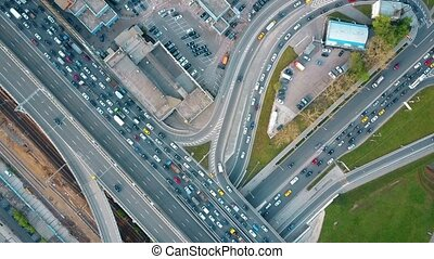Aerial top down view of traffic jam on a city car road in the rush hour. 4K clip