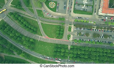 Aerial top down view of traffic on European city roads -...