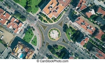 Aerial top down view of urban roundabout traffic in Cordoba,...