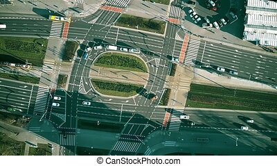 Aerial top down view time lapse of road traffic on big intersection