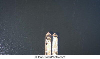 Aerial, top view from Drone: Barge with sand ship sails on...