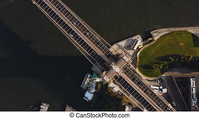 Aerial top view of Brooklyn bridge. Drone turning around the...