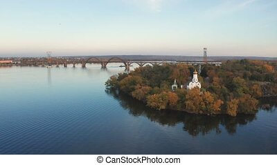 Aerial top view of church on Monastic island on Dnieper...