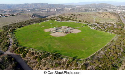 Aerial top view of Community park baseball sports field.