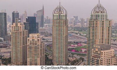 Aerial top view of Dubai Marina day to night timelapse. ...