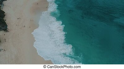 Aerial top view of Kelingking Beach in Nusa Penida, Bali