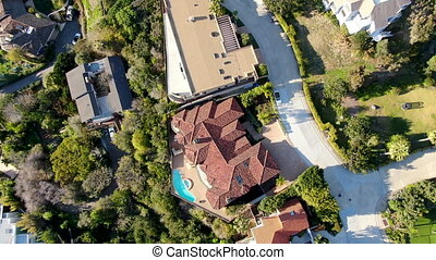 Aerial top view of La Jolla little coastline city with wealthy villas and swimming pool.