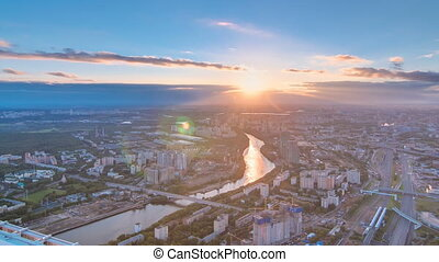 Aerial top view of Moscow city timelapse at sunset. Form...