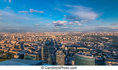 Aerial top view of Moscow city timelapse at sunset. Form from the observation platform of the business center of Moscow City.