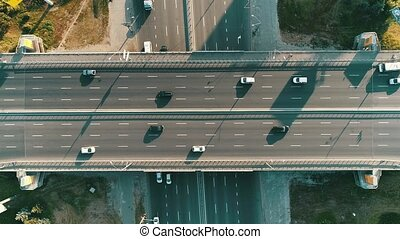 Aerial top view of road junction from above, automobile...