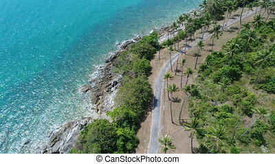 Aerial top view of sea coastline and island with palm trees