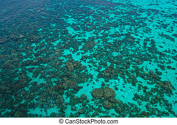 Aerial top view of the crystal clear lagoon sea water surface