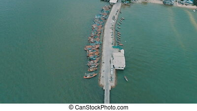 Aerial top view of tour and fishing boats morred on the pier...
