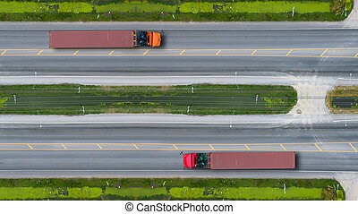 Aerial top view of trucks on road and highway