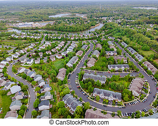 Aerial top view of urban landscape roofs of neighborhood with houses