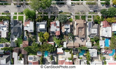 Aerial top view of wealthy area with big houses and small street in Central Los Angeles