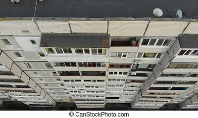 Aerial Top View on Rooftops and Facades of Residential High Rise Buildings, City