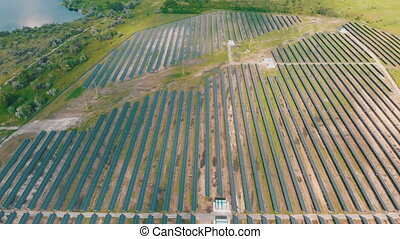 Aerial Top view on Solar Power Station in Green Field on ...