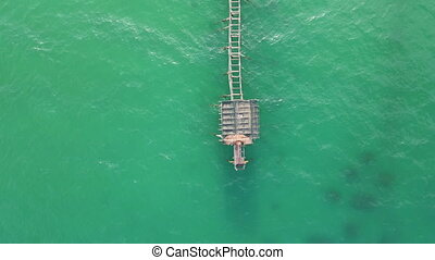 Aerial top view on the wooden pier in tropical sea