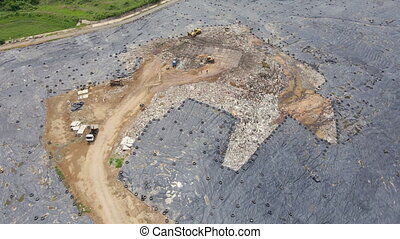 Aerial top view video of a solid waste landfill. City waste ...