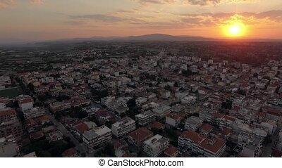 Aerial townscape at sunrise. Nea Kallikratia, Greece -...