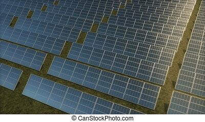 Aerial tracking shot of a solar farm.
