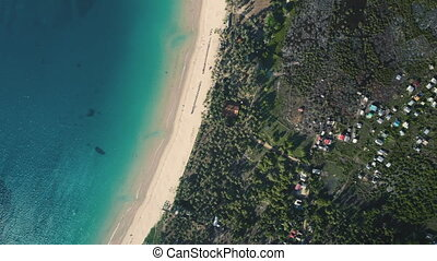 Aerial tropical island beach resort. Paradise summer landscape with green jungle forest and blue ocean water. Exotic summer vacation. Travel destinations, outdoor tourism. Drone flight. Top down view